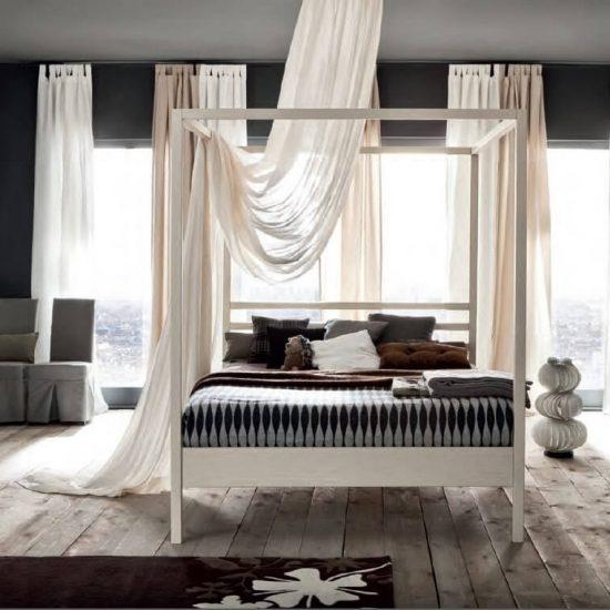 camera con letto con baldacchino in legno massello laccato o naturale